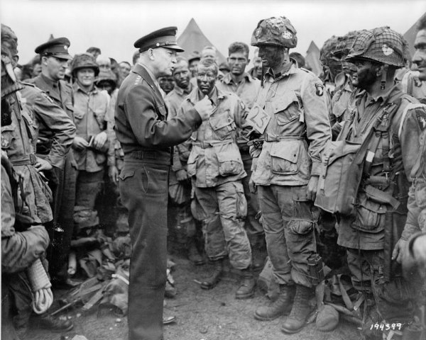 "General Dwight D. Eisenhower tells paratroopers ""Full victory--nothing else"" at Greenham Common, England, on June 5, the eve of the invasion."