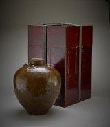 Tea-leaf storage jar named Chigusa and its storage box. -- Courtesy Freer Gallery of Art.
