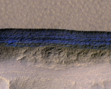 An enhanced-color view of underground ice exposed at the slope.