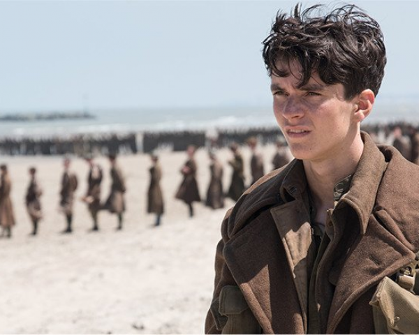 A soldier (Fionn Whitehead) awaits rescue in the film, Dunkirk.